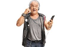 Old punker listening to music on a phone. Isolated on white background stock photos