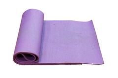 Old purple yoga mat on white background with clipping path. Stock Photography