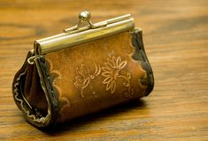 Old purse. On wood table Royalty Free Stock Photo