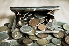 Old purse full of vintage coins. Royalty Free Stock Photos