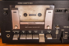 Old quality stereo cassette with tape inside. Vintage Stereo Cassette Tape Deck Recorder Front. Closeup stock image