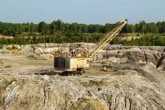 Quarry for the extraction of clay with excavator. royalty free stock image