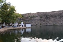 Old quarry filled with water, the resting place of the inhabitants of the town of Kamensk-Shakhtinsky. Stock Images
