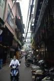 Old quarter of Hanoi, Vietnam. Girls on motorbike  in Old Quarter of Hanoi Royalty Free Stock Photography