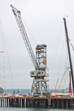 Old quayside crane in Falmouth docks UK Stock Photography
