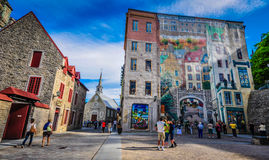 Old Quebec Mural. Mural in Old Québec's Place-Royale recounts the story of Québec City. Look closely to spot 15 historic figures and nearly a dozen of Qué Stock Photos
