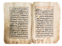 Old quran book over white background Stock Photography