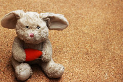 Old rabbit doll drops on brown ground Stock Images