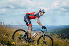 Old racer on the mountain bike downhill Stock Photography