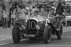 Old racing car and spectators Royalty Free Stock Image
