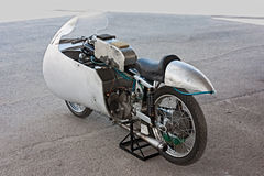 Old racing motorcycle Moto Guzzi. Old italian racing motorcycle Moto Guzzi (1950) exposed at rally of vintage and modern motorbikes Motoconcentrazione della Royalty Free Stock Photography