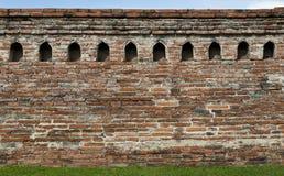 Old rad  brick wall of Thailand Royalty Free Stock Photos
