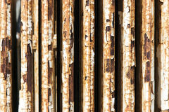 Old radiator with cracked white paint and rust Stock Images