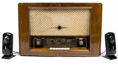 Old radio. And new speakers Royalty Free Stock Photos