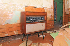 Old radio. In grunge interior Royalty Free Stock Photo