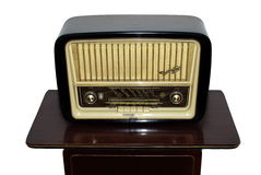 An old radio. On a brown wooden table Stock Photo