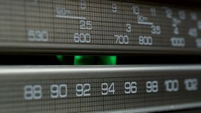 Old radio dial, searching for stations in different radio frequencies stock footage