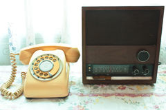 Old radio and retro telephone. Royalty Free Stock Photo