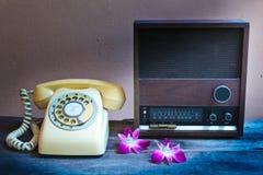 Old radio and retro telephone. Stock Photography