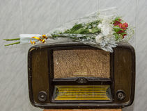 The old radio. Old radio set, which is bouquet of flowers Stock Images