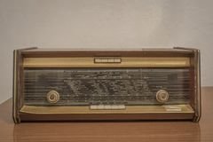 Old radio on a wooden table royalty free stock image