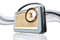 Old radio with sound wave. Close up of old blue and brown vintage radio with grey sound waves in background, isolated on white background Royalty Free Stock Image