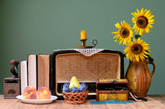 The old radio, sunflower and books Royalty Free Stock Photo