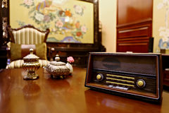 Old radio. On a table with retro background stock photography