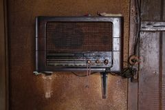 Old radio tuner in old house. Old antique wooden radio set in old house Stock Photography