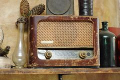 Old radio in vintage setup Royalty Free Stock Images