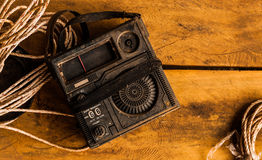 Old radio. On wood table that have some of rope and adventure time Stock Images