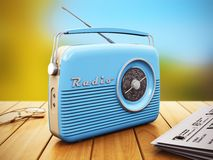 Old radio on wooden table outdoors Stock Image