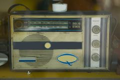 Old radio on the yellow table in the old room. royalty free stock image