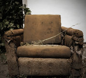 Old rag chair. Stylized photo Stock Image