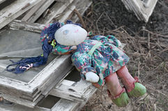 Old rag doll. Forgotten children toy. Old rag doll on the ruins Stock Images