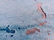 Old ragged blue plaster wall texture and background royalty free stock images