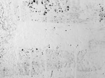 Old ragged stucco plaster wall texture. Cracked background. Wall royalty free stock photo