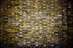 Old ragged wall. Background in style grunge. Old ragged wall with an unusual stone laying Royalty Free Stock Photos