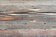 Old ragged wooden grey planks with checks, natural texture Stock Photography