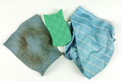 Old rags and sponge on white background. Top view Royalty Free Stock Image