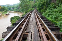 Old rail beside cliff and river Royalty Free Stock Images
