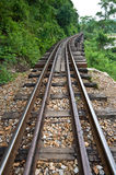 Old rail beside cliff and river Stock Photo