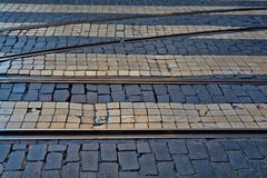 Old rail lines on cobbled road surface.  Stock Photos