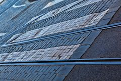 Old rail lines on cobbled road surface.  Royalty Free Stock Photo