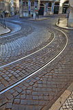 Old rail lines on cobbled road surface. Lisbon Portugal Royalty Free Stock Image