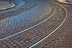 Old rail lines on cobbled road surface.  Royalty Free Stock Images