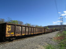 Old rail road cars passing by. Royalty Free Stock Photography
