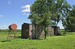 Old railroad boxcar on farm Stock Photos