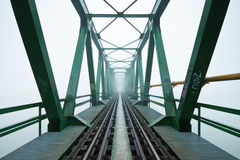 Old railroad bridge in fog Royalty Free Stock Photography