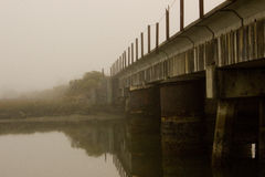 Old railroad bridge on a foggy morning. Old railroad bridge over a bay on a foggy morning Royalty Free Stock Images